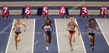 Britain's Asha Philip, 2nd left, Germany's Rebekka Haase, left, Latvia's Sindija Buksa, 2nd right, and France's Nasrane Bacar, right, compete in a heat of the women's 60 meters race during the European Athletics Indoor Championships at the Emirates Arena in Glasgow, Scotland