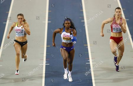 Britain's Asha Philip, center, Germany's Rebekka Haase, left, and Latvia's Sindija Buksa, right, compete in a heat of the women's 60 meters race during the European Athletics Indoor Championships at the Emirates Arena in Glasgow, Scotland