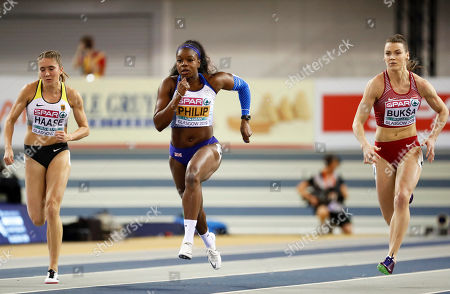 Rebekka Haase of Germany, Asha Philip of Britain and Sindija Buksa of Latvia, from left to right, compete in a heat of the women's 60 meters race at the European Athletics Indoor Championships at the Emirates Arena in Glasgow, Scotland