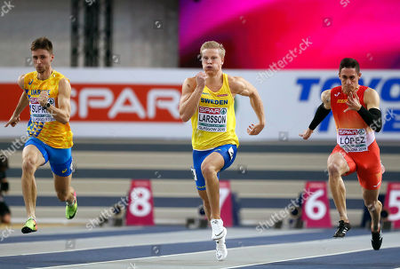 Volodymyr Suprun of Ukraine, Henrik Larsson of Sweden and Sergio Lopez of Spain, from left to right, compete in a heat of the men's 60 meters race at the European Athletics Indoor Championships at the Emirates Arena in Glasgow, Scotland