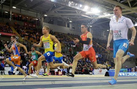 Henrik Larsson of Sweden, center left, and Sergio Lopez of Spain, center right, compete in a heat of the men's 60 meters race at the European Athletics Indoor Championships at the Emirates Arena in Glasgow, Scotland