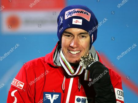 Stefan Kraft of Austria poses with his bronze medal on the podium of the men's Ski Jumping HS109 competition of the 2019 Nordic Skiing World Championships in Seefeld, Austria, 02 March 2019.