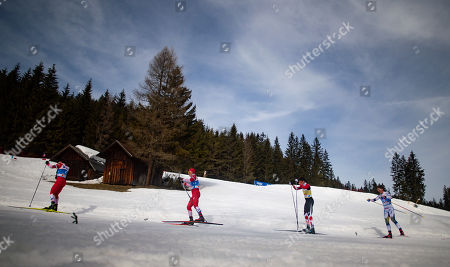 Andrey Melnichenko of Russia (L) and Alexander Bolshunov of Russia (C-L) in action during the Men 50 km Mass Start Free of the 2019 Nordic Skiing World Championships at the Cross-Country Arena Seefeld in Seefeld, Austria, 03 March 2019.