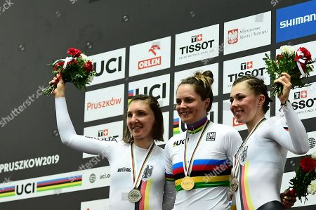 Lisa Klein and Lisa Brennauer of Germany and Ashlee Ankudinoff of Australia celebrates winning the Women's Individual Pursuit wearing the Rainbow Jersey.