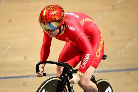 Stock Photo of Lin Junhong of China races the Women's 500m Time Trial.