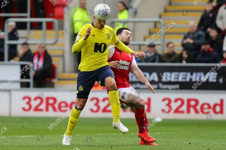 Blackburn Rovers midfielder Jack Rodwell (5) heads the bzll under pressure from Rotherham United midfielder Richard Towell (13) during the EFL Sky Bet Championship match between Rotherham United and Blackburn Rovers at the AESSEAL New York Stadium, Rotherham