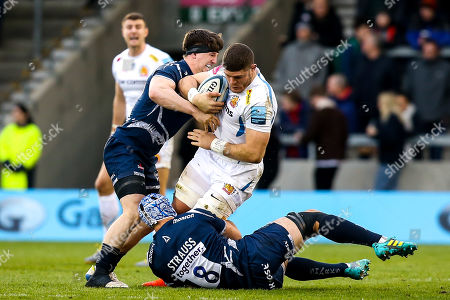 Dave Ewers of Exeter Chiefs is tackled by Josh Strauss of Sale Sharks and Ben Curry of Sale Sharks