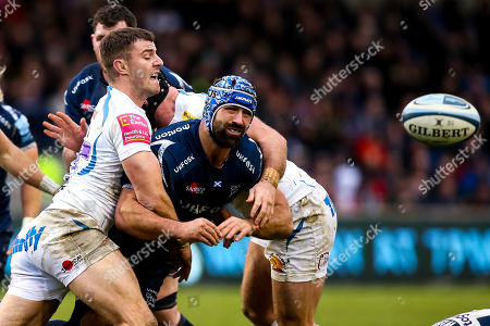 Josh Strauss of Sale Sharks is tackled by Ollie Devoto of Exeter Chiefs