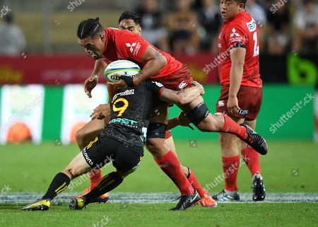 Sunwolves Hendrik Tui is wrapped up in the tackle by Chiefs Brad Weber during the Super Rugby match between Chiefs and Sunwolves in Hamilton, New Zealand, 02 March 2019.