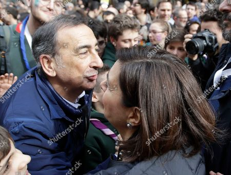Former Lower Chamber of Deputies speaker Laura Boldrini, right, greets Mayor of Milan Giuseppe Sala, left, at in an anti-racism demonstration, in Milan, Italy