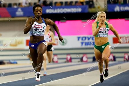 Stock Photo of Kristal Awuah of Britain (L) and Molly Scott of Ireland (R) compete at the women's 60m rounds at the 35th European Athletics Indoor Championships, Glasgow, Britain, 02 March 2019.