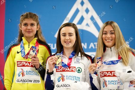 Laura Muir of Britain (C), Konstanze Klosterhalfen of Germany (L) and Melissa Courtney of Britain (R) on the pocium of the  3000m at the 35th European Athletics Indoor Championships, Glasgow, Britain, 2nd March 2019.