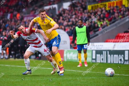 Ben Purrington of Charlton Athletic (16) and Aaron Lewis of Doncaster Rovers (44) in action during the EFL Sky Bet League 1 match between Doncaster Rovers and Charlton Athletic at the Keepmoat Stadium, Doncaster