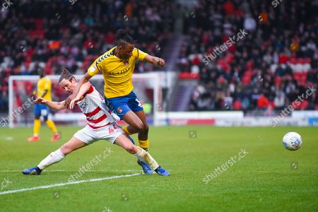 Aaron Lewis of Doncaster Rovers (44) tackles Joe Aribo of Charlton Athletic (17) during the EFL Sky Bet League 1 match between Doncaster Rovers and Charlton Athletic at the Keepmoat Stadium, Doncaster