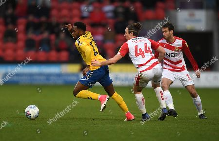 Tariqe Fosu of Charlton Athletic and Aaron Lewis of Doncaster Rovers