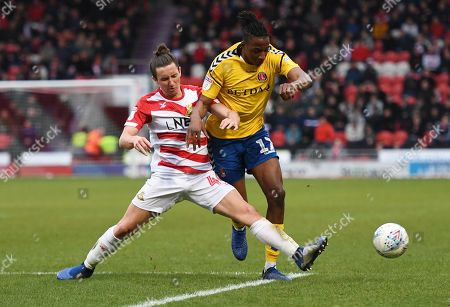 Joe Aribo of Charlton Athletic is tackled by Aaron Lewis of Doncaster Rovers