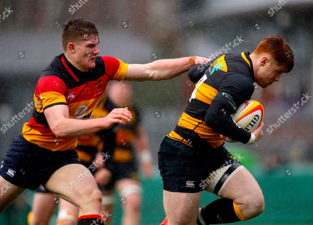 Lansdowne vs Young Munster. Lansdowne's Peter Sullivan tackles Conor Phillips of Young Munster