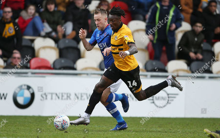 Stock Image of Adebayo Azeez of Newport County is tackled by Jason Kennedy of Carlisle United.