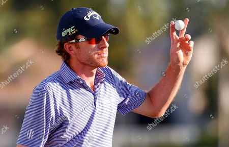 Roberto Castro acknowledges the crowd after finishing the 18th hole during the third round of the Honda Classic golf tournament, in Palm Beach Gardens, Fla