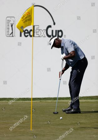 Vijay Singh, of Fiji, putts on the ninth hole during the third round of the Honda Classic golf tournament, in Palm Beach Gardens, Fla