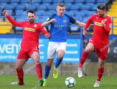 Glenavon vs Cliftonville. Glenavon's Andrew Mitchell with Cliftonville's Jamie Harney and Garry Breen