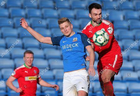 Glenavon vs Cliftonville. Glenavon's Andrew Mitchell with Cliftonville's Jamie Harney