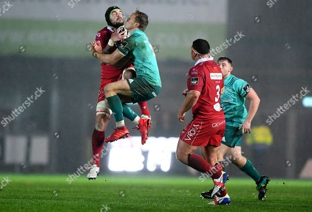 Scarlets vs Munster. Tom Price of Scarlets beats Mike Haley of Munster to the ball