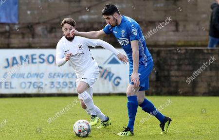 Dungannon Swifts vs Ballinamallard United. Dungannon's Kris Lowe with Christopher Kelly of Ballinamallard United