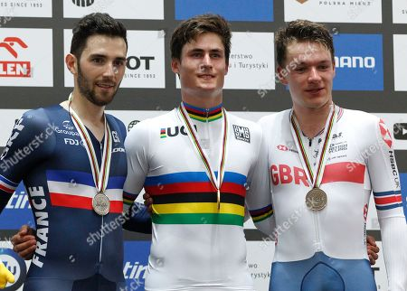 Men's Omnium race silver medalist France's Benjamin Thomas, left, gold winner New Zeland's Campbell Stewart, center, and bronze medalist Great Britain's Ethan Hayter pose on the podium at the UCI Track Cycling World Championship in Pruszkow, Poland