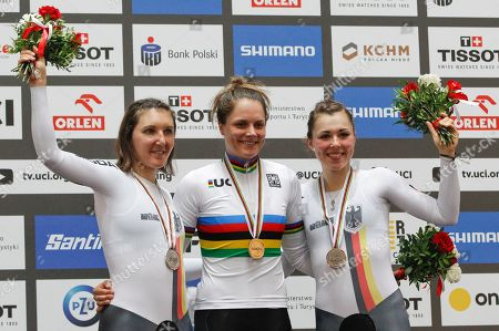 Women's Individual Pursuit silver medalist Germany's Lisa Brennauer, left, gold medalist Australia's Ashlee Ankudinoff, center, and bronze medalist Germany's Lisa Klein pose on the podium at the UCI Track Cycling World Championship in Pruszkow, Poland