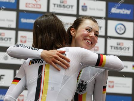 Women's Individual Pursuit silver medalist Germany's Lisa Brennauer hugs bronze medalist Germany's Lisa Klein on the podium at the UCI Track Cycling World Championship in Pruszkow, Poland