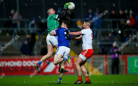 Stock Picture of Tyrone vs Cavan. Tyrone's Richard Donnelly with Raymond Galligan and Padraig Faulkner of Cavan