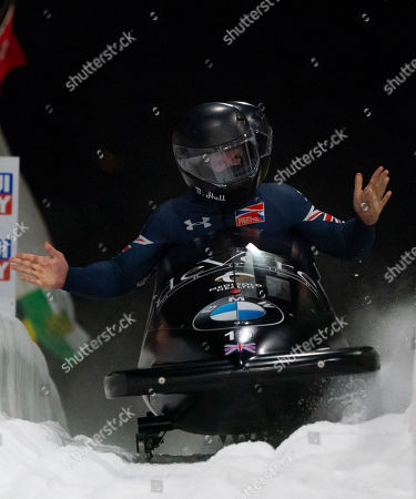 Brad Hall and Nick Gleeson of Britain react after finishing the two-man Bobsleigh event at the IBSF Bobsleigh & Skeleton World Championships in Whistler, Canada, 02 March 2019.