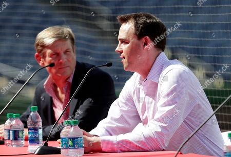 Philadelphia Phillies general manager Matthew Klentak, right, speaks as managing partner John Middleton looks on before Bryce Harper is introduced as a Philadelphia Phillies player during a news conference at the Philadelphia Phillies spring training baseball facility, in Clearwater, Fla. Harper and the Phillies agreed to a $330 million, 13-year contract, the largest deal in baseball history