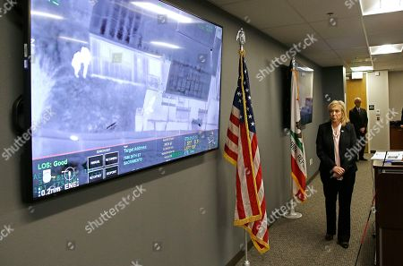 Sacramento County District Attorney Anne Marie Schubert displays a video from a Sacramento County Sheriff's helicopter in last year's fatal shooting of an unarmed black man, during a news conference in Sacramento, Calif., . Schubert said that Officers Terrance Mercadal and Jared Robinet did not break any laws when they shot Stephon Clark after the 22-year-old vandalism suspect ran from them into his grandparents' backyard last year