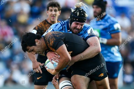 Jaguares' Javier Ortega Desio (L) in action against Blues' Ma Nonu during a Super Rugby match between Jaguares and Blues at the Velez Sarfield, in Buenos Aires, Argentina, 02 March 2019.