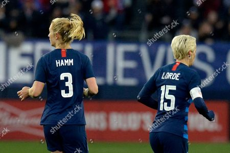 United States midfielder Samantha Mewis (3) and forward Megan Rapinoe (15) play against England during the second half of a SheBelieves Cup women's soccer match, in Nashville, Tenn. Mewis honors Mia Hamm and Rapine honors Audre Lorde by wearing their names on the back of their jerseys