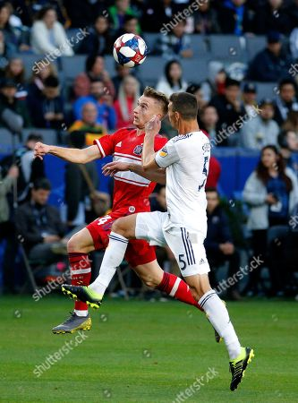 Chicago Fire midfielder Djordje Mihailovic, left, and LA Galaxy defender Daniel Steres battle for a ball in the first half of an MLS soccer match in Carson, Calif