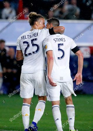 LA Galaxy defender Daniel Steres, right, celebrates his goal with teammate defender Rolf Feltscher of Switzerland, in the second half of an MLS soccer match against Chicago Fire in Carson, Calif
