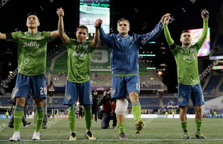 Seattle Sounders forward Jordan Morris, second from right, celebrates with teammates Kim Kee-Hee, left, Raul Ruidiaz, second from left, and Victor Rodriguez, right, after the Sounders defeated FC Cincinnati 4-1 in an MLS soccer match, in Seattle. Morris scored two goals and Ruidiaz scored one in the match