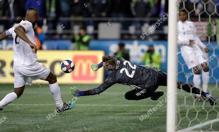 FC Cincinnati goalkeeper Przemyslaw Tyton (22) dives for the ball as defender Kendall Waston, left, watches during the second half of the team's MLS soccer match against the Seattle Sounders, in Seattle. The Sounders won 4-1