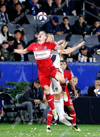Chicago Fire midfielder Bastian Schweinsteiger (31) of Germany, and LA Galaxy forawrd Zlatan Ibrahimovic (9) of Swede, battle for a head ball during an MLS soccer match between LA Galaxy and Chicago Fire in Carson, Calif., . The Galaxy won 2-1