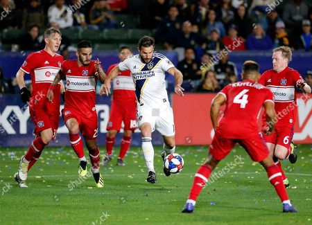 LA Galaxy forward Chris Pontius (12) controls the ball during an MLS soccer match between LA Galaxy and Chicago Fire in Carson, Calif., . The Galaxy won 2-1
