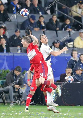 LA Galaxy forawrd Zlatan Ibrahimovic (9) of Sweden, vies the ball against Chicago Fire midfielder Bastian Schweinsteiger (31) of Germany, during an MLS soccer match between LA Galaxy and Chicago Fire in Carson, Calif., . The Galaxy won 2-1