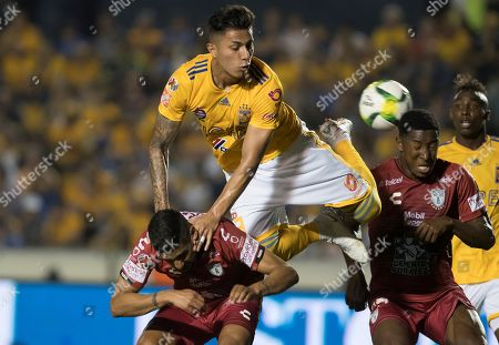 Carlos Salcedo (C) of Tigres UANL in action against Victor Sosa (L) and Oscar Murillo (R) of Pachuca during the 2019 Clausura Tournament soccer match between Tigres UANL and Pachuca, at the Universitario Stadium in Monterrey, Mexico, 02 March 2019.