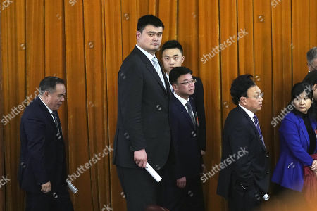 Former NBA player Yao Ming (C) leaves after the opening of the Second Session of the 13th Chinese People's Political Consultative Conference (CPPCC) National Committee at the Great Hall of the People (GHOP) in Beijing, China, 03 March 2019. The CPPCC is the top advisory body of the Chinese political system and runs alongside the annual plenary meetings of the 13th National People's Congress (NPC), together known as 'Lianghui' or 'Two Meetings'.