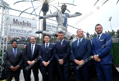 From left to right, LLoyd Dean, Dan Beckerman, Robbie Keane, David Beckham, Bruce Arena and Chris Klein pose with the newly unveiled statue of former Los Angeles Galaxy midfielder David Beckham at Legends Plaza in front of Dignity Health Sports Park in Carson, Calif