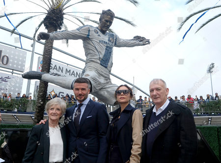 Stock Photo of David Beckham, second from left, his wife Victoria Bekcham, second from right and his parents David Edward Alan Beckham, right, and Sandra Beckham pose with the newly unveiled statue of former Los Angeles Galaxy midfielder David Beckham at Legends Plaza in front of Dignity Health Sports Park in Carson, Calif