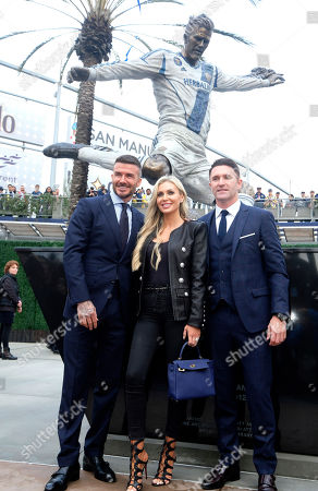 Robbie Keane, right, his wife wife Claudine Keane, center, and David Beckham pose with the newly unveiled statue of former Los Angeles Galaxy midfielder David Beckham at Legends Plaza in front of Dignity Health Sports Park in Carson, Calif