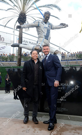 Cobi Jones, left, and David Beckham pose with the newly unveiled statue of former Los Angeles Galaxy midfielder David Beckham at Legends Plaza in front of Dignity Health Sports Park in Carson, Calif